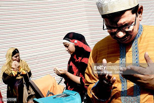 ROME ITALY JULY Muslim migrant in Torpignattara a multiethnic suburb of Rome for the prayer of Eid alFitr which marks the end of the Ramadan fasting...