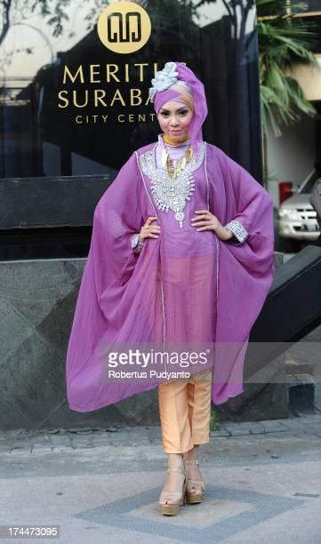 Muslim models wear Bohemian Kaftan by Amelia in a fashion show as Ramadan observers break their fast on July 26 2013 in Surabaya Indonesia Indonesia...