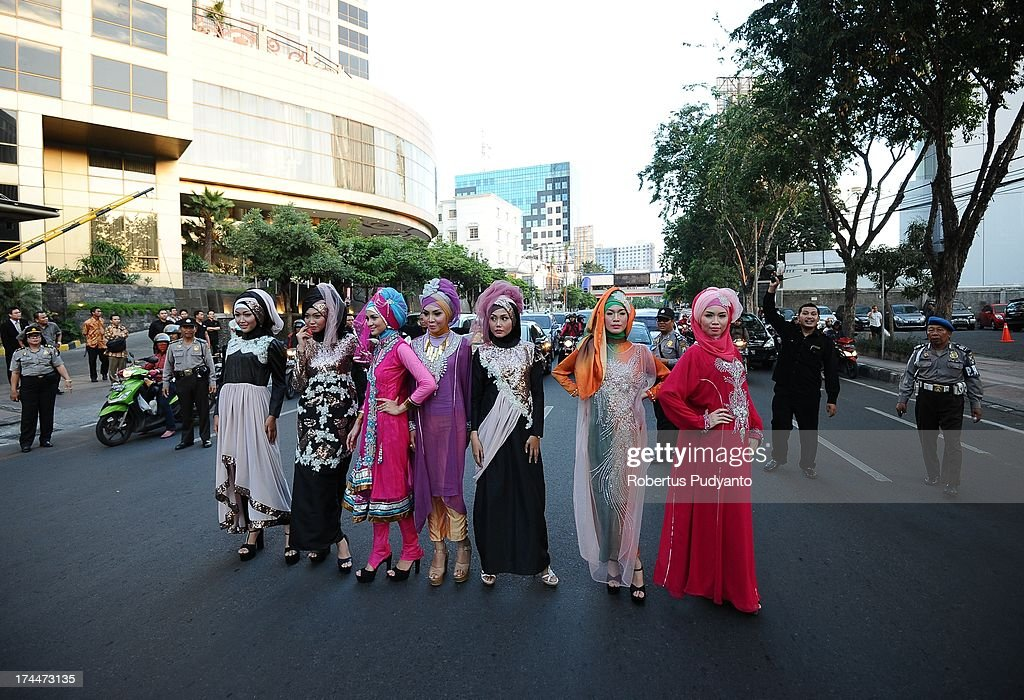 Muslim models wear Bohemian Kaftan by Amelia in a fashion show as Ramadan observers break their fast on July 26, 2013 in Surabaya, Indonesia. Indonesia hopes to become the Paris of Muslim fashion by 2020 with modern designs in a variety of textures and colors. Indonesians celebrate the month of Ramadan by abstaining from eating, drinking, and smoking as well as sexual activities from dawn to dusk.
