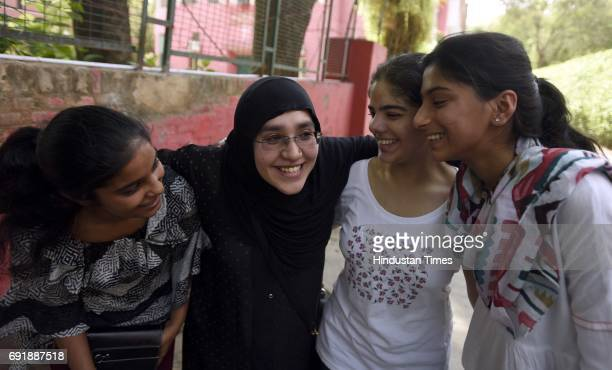 Muslim mother with her daughter and her friends celebrates at St Thomas School after the class 10th CBSE result announced on June 3 2016 in New Delhi...