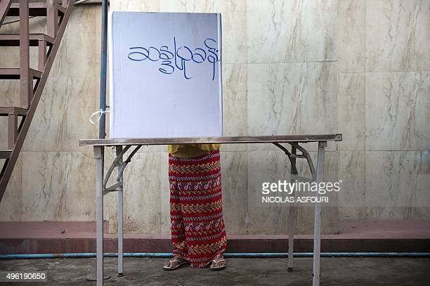 A Muslim Myanmar voter casts her vote at a polling station in Yangon on November 8 2015 Myanmar goes to the polls in an historic election that could...