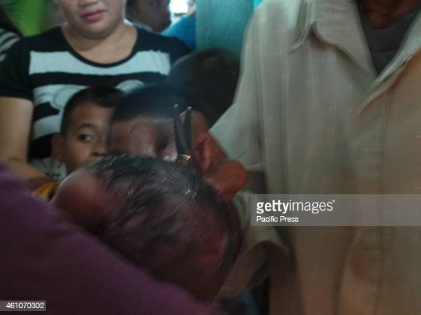 Muslim of Bongao TawiTawi celebrates Mauludin Nabi or the birthday of Prophet Mohammad by doing ritual of cutting a piece of hair of one year old...
