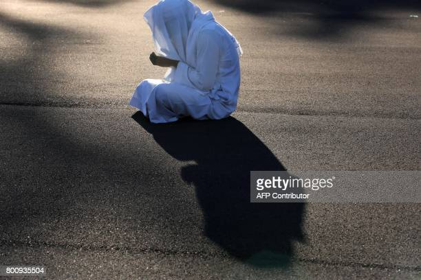 Muslim offer prayers during Eid alFitr at the velodrome de ChampFleuri in SaintDenis de la Reunion on the French Indian Ocean island of Reunion on...