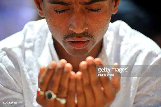 Muslim offering Ritual Prayer during celebration of Eid alFitr by attending special prayers in mosques exchanging greetings with each other wearing...
