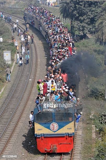 Muslim participants ride on an overcrowded train following the conclusion of the World Muslim Congregation also known as Biswa Ijtema at Tongi on the...
