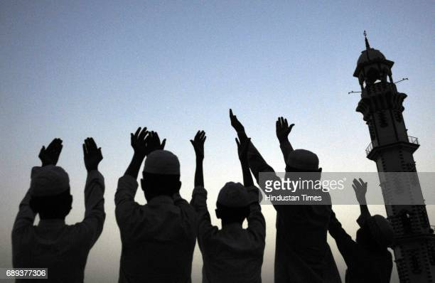 Muslim people gather at the Masjid to break their first Roza as the holy month of Ramadan begins on May 28 2017 in Noida India Ramadan is the ninth...