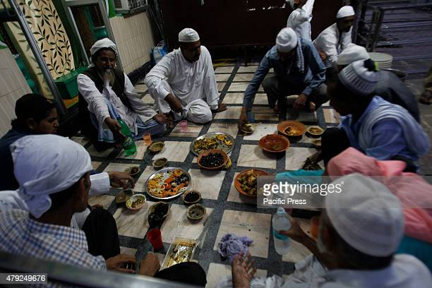 Muslim people taking iftar out side the Line Saha Baba Dargaha during Ramadan