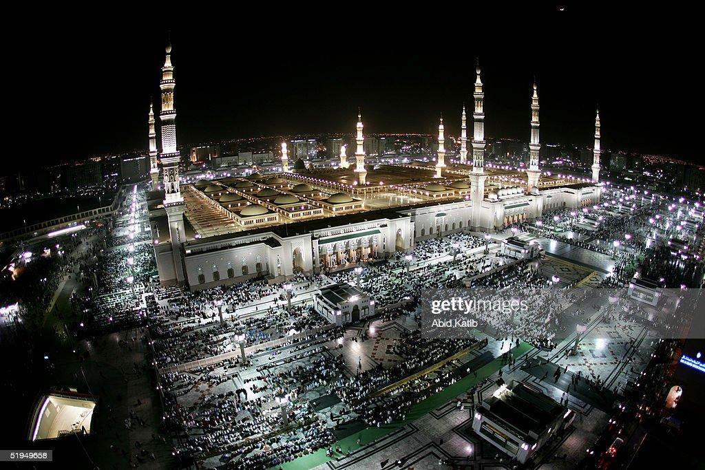 Muslim pilgramges pray the AlEsha'a prayer in the Prophet Mohammed Mosque January 13 2005 in Medina Saudi Arabia Pilgrams began arriving in Saudi...