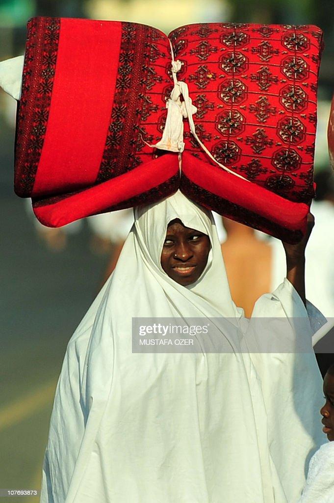 A Muslim pilgrim arrives in Mina five kilometres east of the Saudi Arabian holy city of Mecca on November 14 as some 25 million Muslim pilgrims...