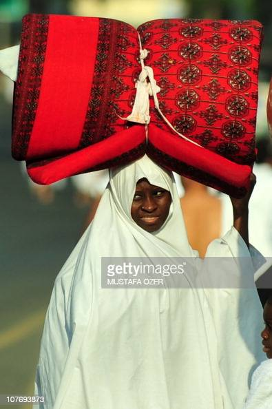 A Muslim pilgrim arrives in Mina five kilometres east of the Saudi Arabian holy city of Mecca on November 14 as some 25 million Muslim pilgrims...