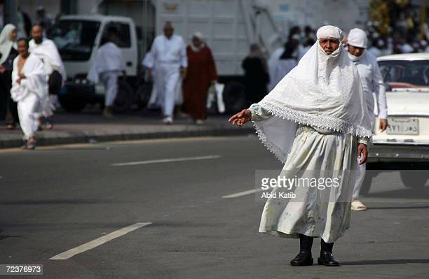 A muslim pilgrim hails a taxi on January 16 2005 in Mecca Saudi Arabia Around two million Muslim pilgrims from around the world are expected to...