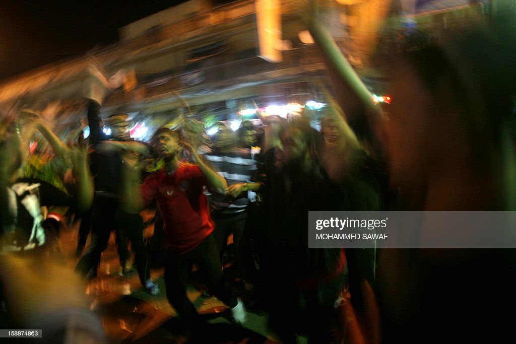 Muslim pilgrim men take part in the Arbaeen religious rituals which marks the 40th day after Ashura commemorating the seventh century killing of Prophet Mohammed's grandson, Imam Hussein, in the shrine city of Karbala, southwest of Iraq's capital Baghdad, on January 2, 2013.