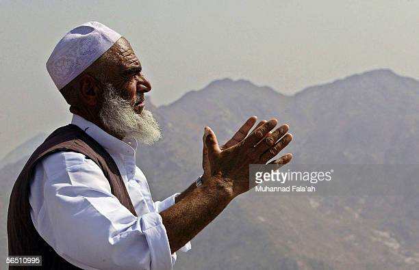 Muslim pilgrim prays adjacent to Heera cave where according to the Muslims belief Prophet Muhammad received the revelation of the holy Muslim book...
