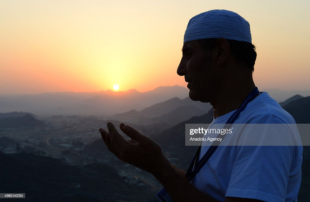 A Muslim pilgrim prays at the top of al Nour mountain (Jabal al-Nour) near Hira cave where Prophet Muhammad received the first revelation of the Quran, on September 28, 2013 in Mecca, Saudi Arabia. The Hajj is an Islamic pilgrimage to Mecca and the largest gathering of Muslim people in the world every year. One of the five pillars of Islam requires every able bodied Muslim to perform the Hajj pilgrimage at least once in his or her lifetime if he or she can afford to do so.