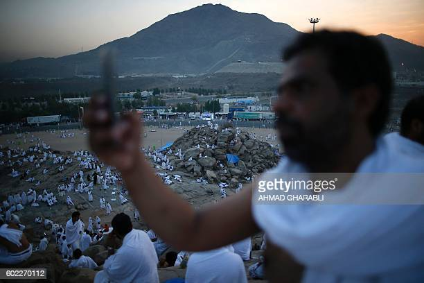 A Muslim pilgrim takes a selfie as he joins one of the Hajj rituals on Mount Arafat near Mecca early on September 11 2016 Close to 15 million Muslims...