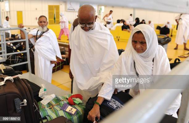 Muslim pilgrims arrive at the King Abdul Aziz airport upon their arrival to the Red Sea port city of Jeddah on September 4 2016 Muslim pilgrims are...