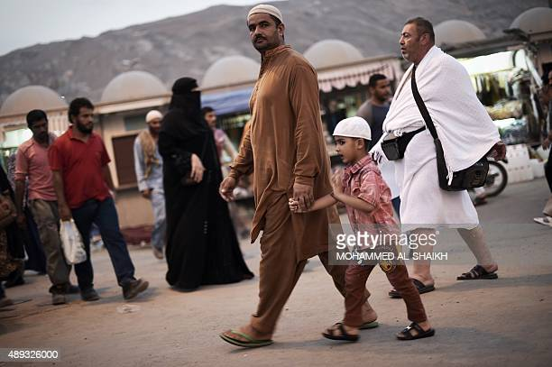 Muslim pilgrims arrive for the Maghrib late afternoon prayer at the Grand Mosque in the Saudi holy city of Mecca on September 20 2015 The annual hajj...