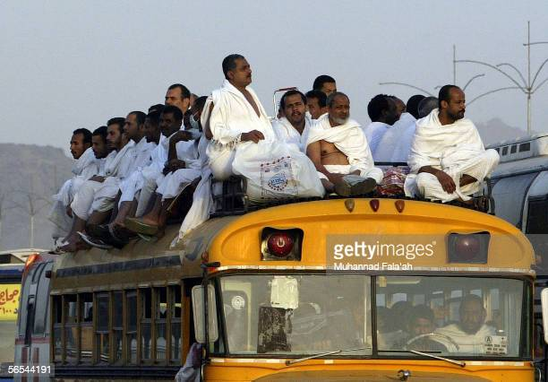 Muslim pilgrims arrive on top of a bus on January 9 2006 in Arafat outside the holy city of Mecca in Saudi Arabia Muslim pilgrims have journeyed...