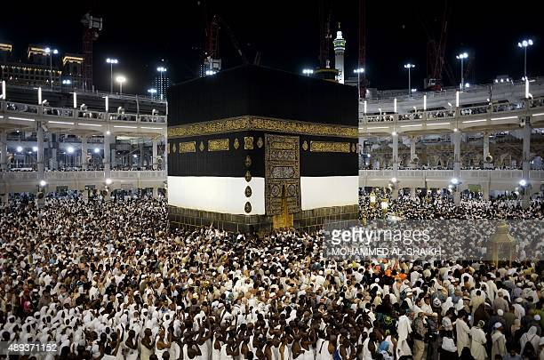 Muslim pilgrims circle counterclockwise Islam's holiest shrine the Kaaba at the Grand Mosque in the Saudi holy city of Mecca late on September 20...
