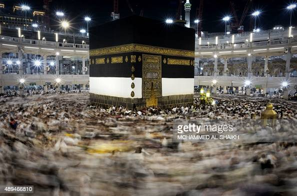 Muslim pilgrims circle counterclockwise Islam's holiest shrine the Kaaba at the Grand Mosque in the Saudi holy city of Mecca late on September 21...
