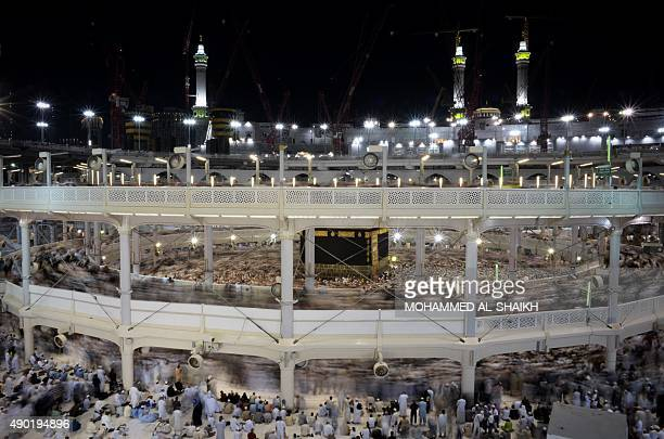Muslim pilgrims circle counterclockwise Islam's holiest shrine the Kaaba at the Grand Mosque in Saudi Arabia's holy Muslim city of Mecca late on...