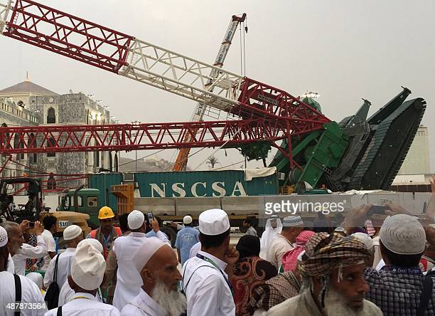 Muslim pilgrims gather in front the crane that collapsed the day before at the Grand Mosque in Saudi Arabia's holy Muslim city of Mecca on September...