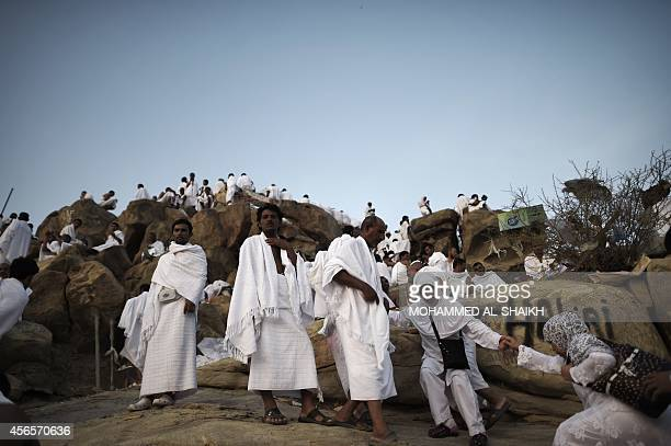 Muslim pilgrims gather on Mount Arafat near Mecca as they perform one of the Hajj rituals late on October 3 2014 The pilgrims perform a series of...