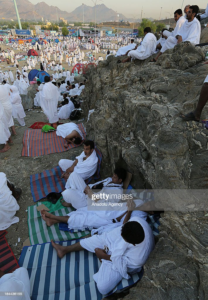 Muslim pilgrims gather on Mount Arafat, near Mecca, on October 14, 2013. The pilgrims perform a series of rituals during the annual Hajj. They circumambulate the kaaba seven times, runs back and forth between the hills of Al-Safa and Al-Marwah, drink from the Zamzam Well, goes to the plains of Mount Arafat to stand in vigil, and throws stones in a ritual Stoning of Devil. The pilgrims then shave their heads, perform a ritual of animal sacrifice, and celebrate Eid al-Adha holiday.