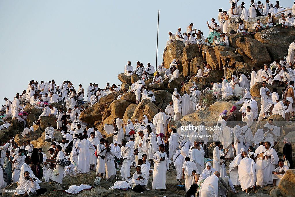 Muslim pilgrims gather on Mount Arafat, near Mecca, to take part in one of the Hajj rituals on October 14, 2013. The pilgrims perform a series of rituals during the annual Hajj. They circumambulate the kaaba seven times, runs back and forth between the hills of Al-Safa and Al-Marwah, drink from the Zamzam Well, goes to the plains of Mount Arafat to stand in vigil, and throws stones in a ritual Stoning of Devil. The pilgrims then shave their heads, perform a ritual of animal sacrifice, and celebrate Eid al-Adha holiday.
