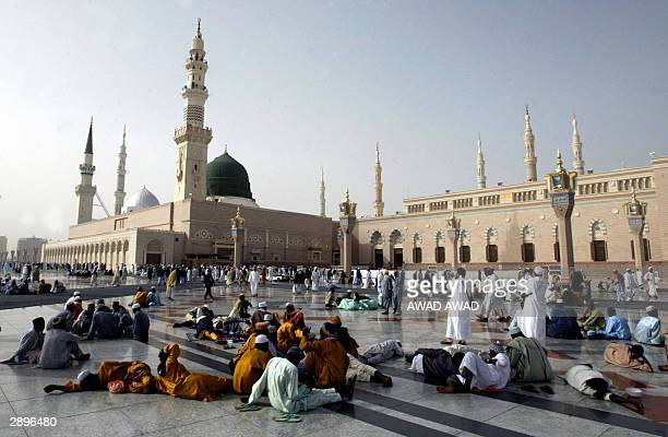 Muslim pilgrims gather outside the Prophet Mohammed's Mosque in Medina 24 January 2004 More than 11 million Muslims from around the world have...
