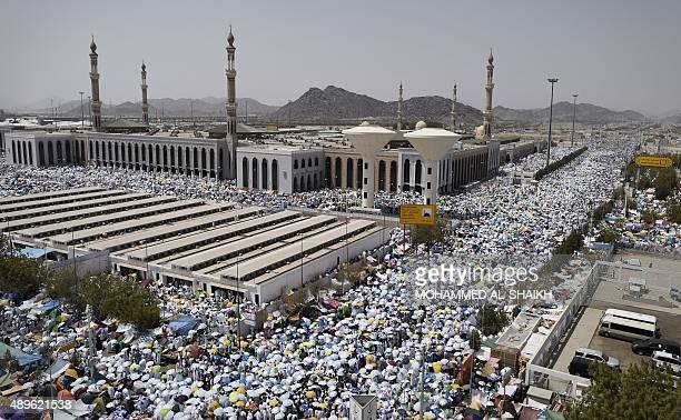 Muslim pilgrims gather to perform noon and afternoon prayers at Namira Mosque in Mount Arafat southeast of the Saudi holy city of Mecca on September...