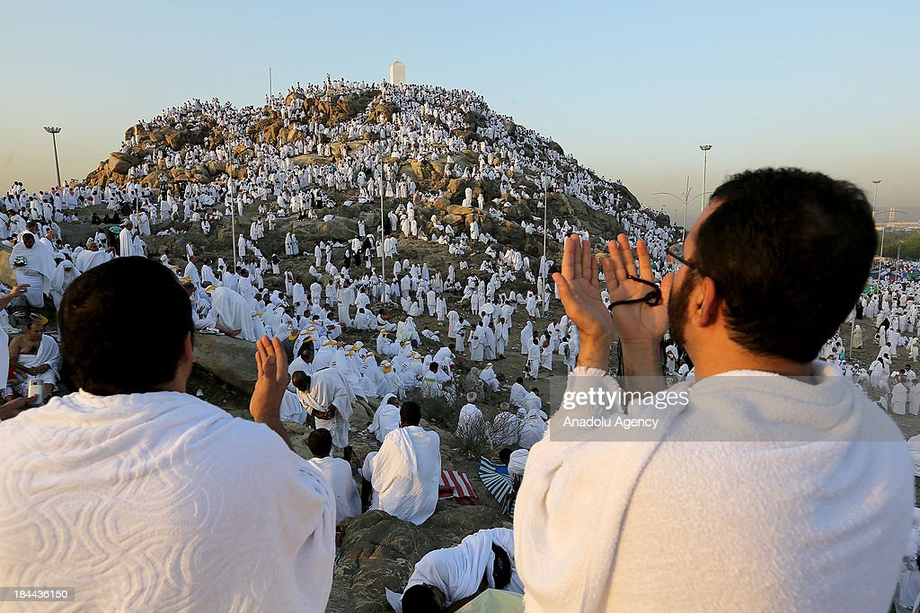 Muslim pilgrims gathering on Mount Arafat near Mecca pray on October 14 2013 The pilgrims perform a series of rituals during the annual Hajj They...