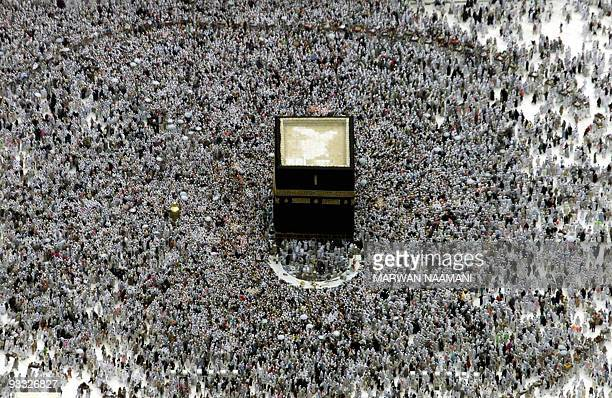 Muslim pilgrims go around the Kaaba in Mecca following the stoning ritual in Mina 06 March 2001 a day after 35 people were killed in a stampede The...