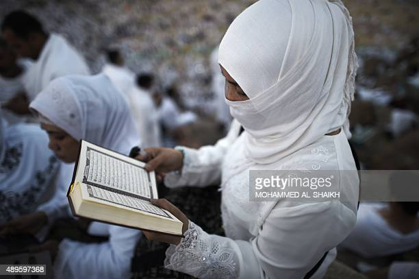 Muslim pilgrims join one of the Hajj rituals on Mount Arafat near Mecca early on September 23 2015 Arafat Day on the 9th of the Islamic month of Dhul...