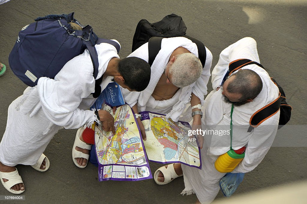 Muslim pilgrims look at a map as they arrive at the Mina valley five kilometres east of the Saudi Arabian holy city of Mecca on November 14 as some...