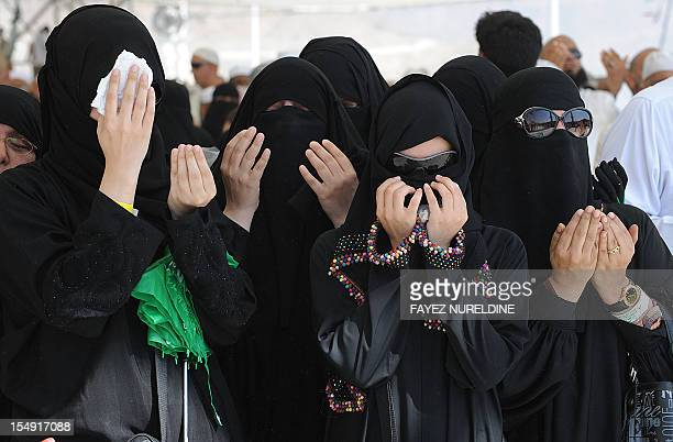Muslim pilgrims pray after threwing pebbles at pillars during the 'Jamarat' ritual the stoning of Satan in Mina near the holy city of Mecca on...