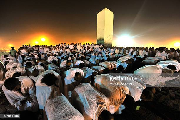 Muslim pilgrims pray at Mount Arafat southeast of the Saudi holy city of Mecca on November 15 2010 Pilgrims flooded into the Arafat plain from Mecca...