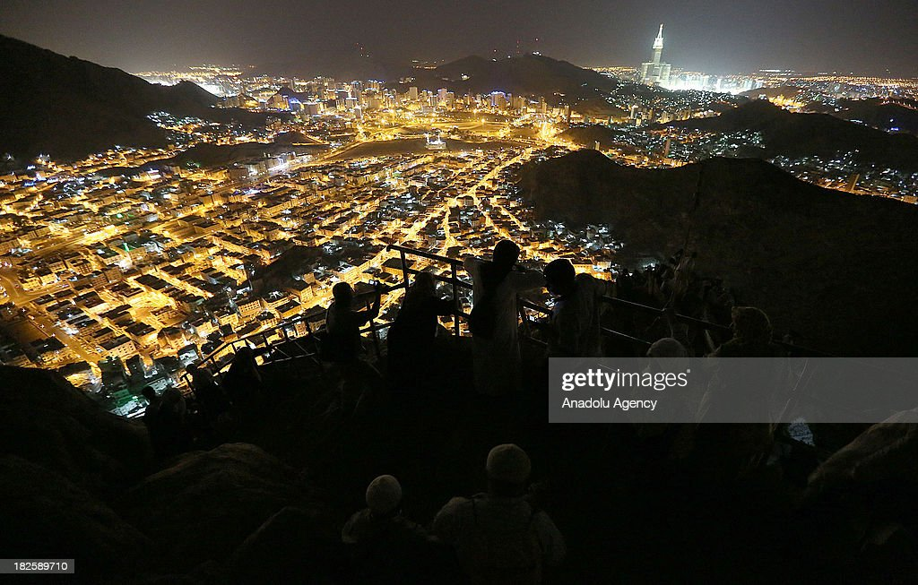 Muslim pilgrims pray at the top of al Nour mountain (Jabal al-Nour) near Hira cave where Prophet Muhammad received the first revelation of the Quran, on October 01, 2013 in Mecca, Saudi Arabia. The Hajj is an Islamic pilgrimage to Mecca and the largest gathering of Muslim people in the world every year. One of the five pillars of Islam requires every able bodied Muslim to perform the Hajj pilgrimage at least once in his or her lifetime if he or she can afford to do so.