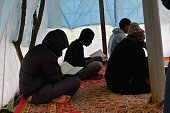 Muslim pilgrims pray in a makeshift mosque set up in a wooded area in Calais northern France adjacent to Calais ferry port where migrants mainly from...