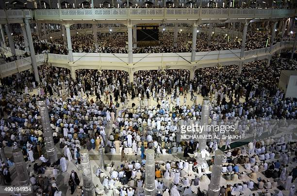Muslim pilgrims pray near the Islam's holiest shrine the Kaaba at the Grand Mosque in Saudi Arabia's holy Muslim city of Mecca late on September 26...