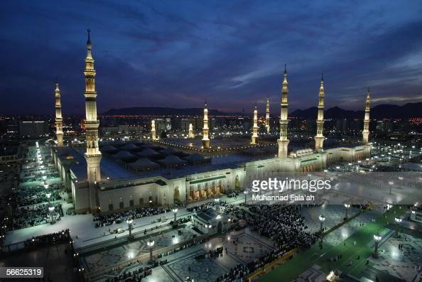 Muslim pilgrims pray near the Prophet Muhammad mosque on January 19 2006 in the holy city of Medina Saudi Arabia Saudi authorities are turning...