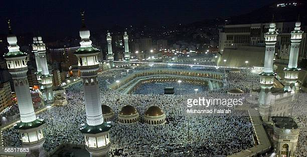 Muslim pilgrims pray the evening prayer inside the Grand Mosque and Holy Kabba the holiest places for Muslims around the world on January 3 2006 in...