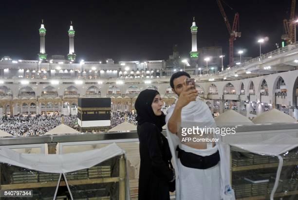 Muslim pilgrims take a selfie at the Grand Mosque in the holy Saudi city of Mecca early on August 30 on the eve of the start of the annual Hajj...