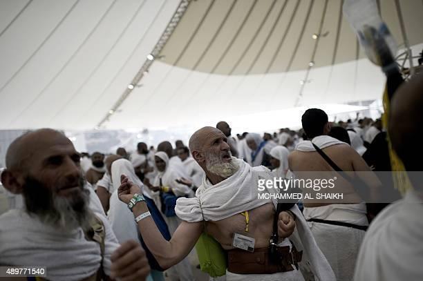 Muslim pilgrims throw pebbles at pillars during the 'Jamarat' ritual the stoning of Satan in Mina near the holy city of Mecca on September 24 2015...