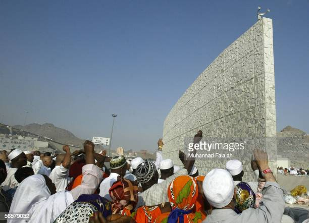 Muslim pilgrims throw stones at a pillar on January 12 2006 in Mina Saudi Arabia At least 350 peole died during a stampede while many pilgrims were...