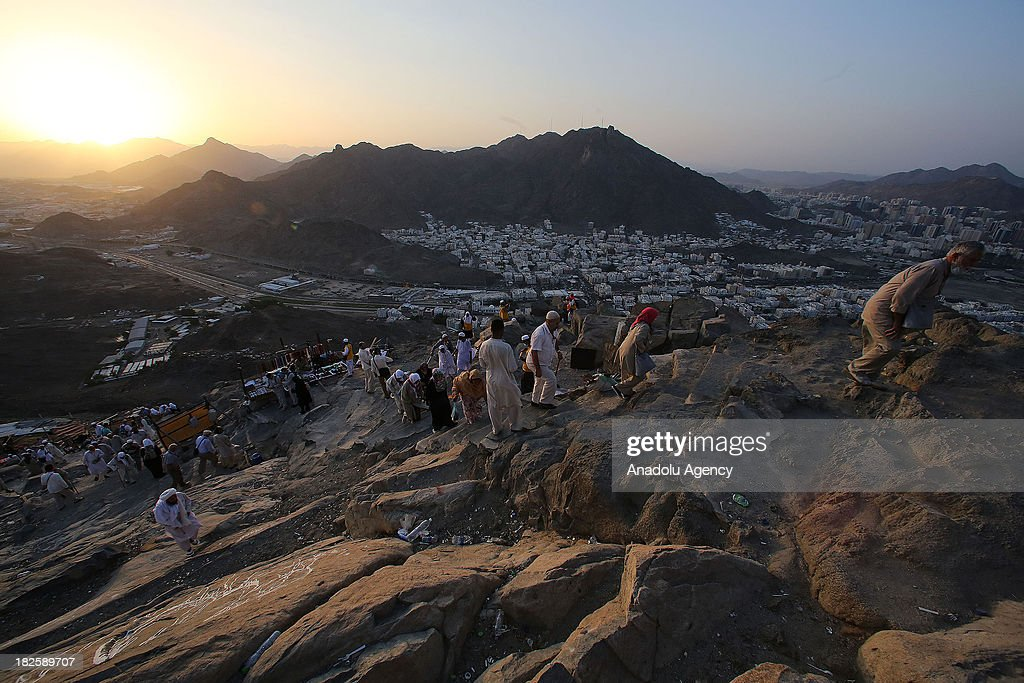 Muslim pilgrims visit the al-Noor mountain (Jabal al-Nour)where the Hira cave is located on October 01, 2013 in Mecca, Saudi Arabia. The Hajj is an Islamic pilgrimage to Mecca and the largest gathering of Muslim people in the world every year. One of the five pillars of Islam requires every able bodied Muslim to perform the Hajj pilgrimage at least once in his or her lifetime if he or she can afford to do so.