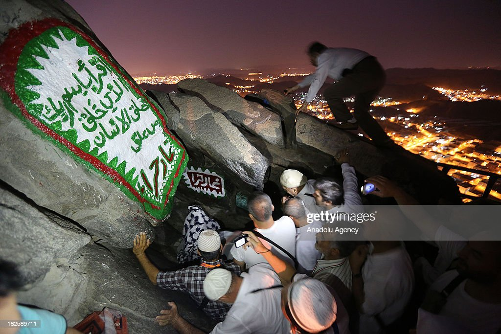 Muslim pilgrims visit the Hiraa cave where Prophet Muhammad received the first revelation of the Quran, at the top of al Nour mountain (Jabal al-Nour) on October 01, 2013 in Mecca, Saudi Arabia. The Hajj is an Islamic pilgrimage to Mecca and the largest gathering of Muslim people in the world every year. One of the five pillars of Islam requires every able bodied Muslim to perform the Hajj pilgrimage at least once in his or her lifetime if he or she can afford to do so.