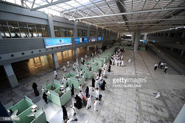Muslim pilgrims wait in line as they arrive at Jeddah airport on October 30 2011 before going to the Saudi holy city of Mecca where they will take...