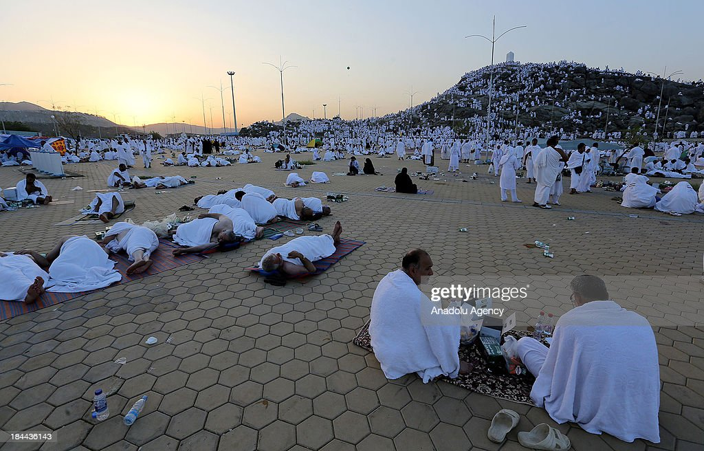 Muslim pilgrims wait in vigil on Mount Arafat, near Mecca, to take part in one of the Hajj rituals on October 14, 2013. The pilgrims perform a series of rituals during the annual Hajj. They circumambulate the kaaba seven times, runs back and forth between the hills of Al-Safa and Al-Marwah, drink from the Zamzam Well, goes to the plains of Mount Arafat to stand in vigil, and throws stones in a ritual Stoning of Devil. The pilgrims then shave their heads, perform a ritual of animal sacrifice, and celebrate Eid al-Adha holiday.