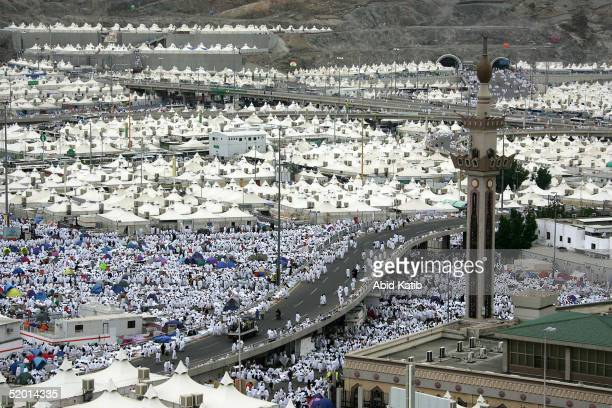 Muslim pilgrims walk amongst thousands of tents set up near a mosque which is located approximately three kilometres southeast of Mecca January 18...